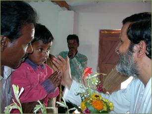 Baba Shuddhaanandaa with child in India